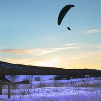 Buy canvas prints of Paraglider landing by Jon Pankhurst