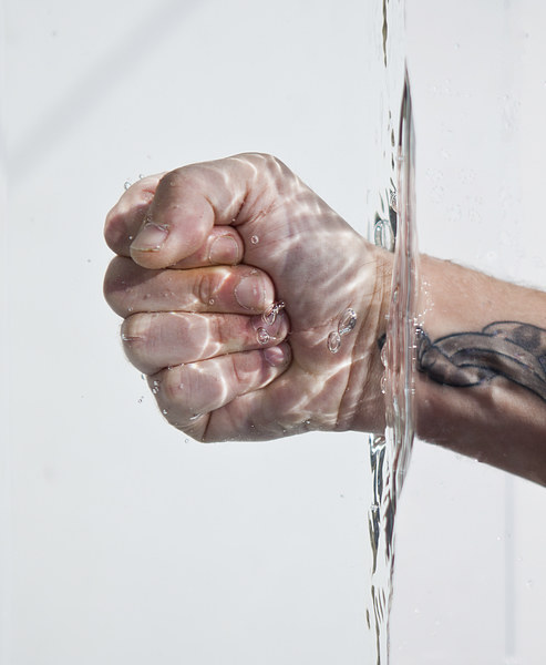 Hand in water Canvas Print by David Pacey