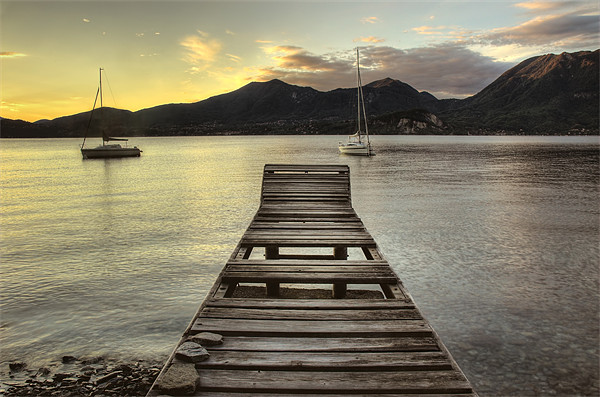 Lake Maggiore jetty, Italy Print by Martin Williams