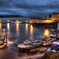 Buy canvas prints of Tenby Harbour High Tide by Simon West