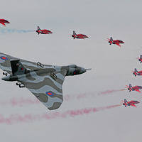 Buy canvas prints of  Vulcan and red arrows flypast by Rachel & Martin Pics