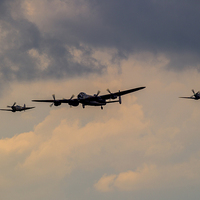 Buy canvas prints of  BBMF Trio - Lancaster and Spitfires by Keith Campbell