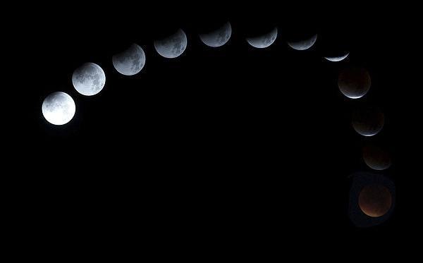 Lunar eclipse by JCstudios Canvas print by John Cuthbert