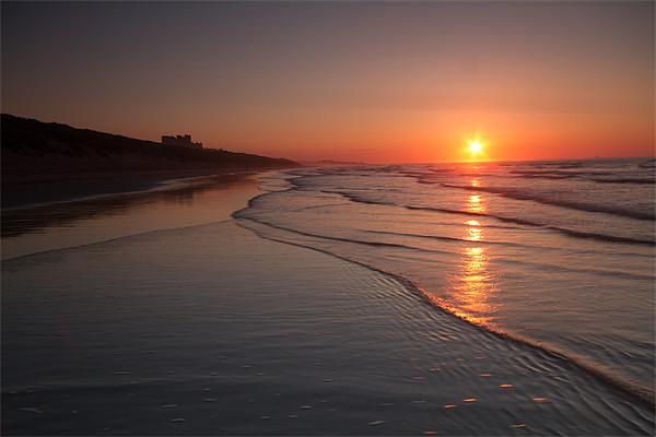 Bamburgh Sunset Canvas print by Neil Coleran