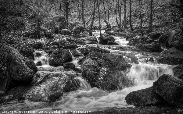 Fast flowing water  Canvas print by Jon Fixter