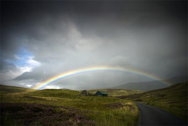 Rainbow on Glen Lyon Canvas Print by Ian Potter