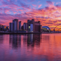 Buy canvas prints of  Awsome fiery sunset over Necastle Upon Tyne by Tom Hibberd