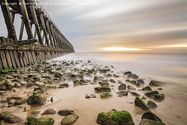 An old pier and a warm sun Canvas print by Tom Hibberd