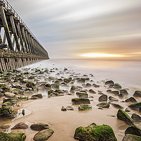 Buy canvas prints of An old pier and a warm sun by Tom Hibberd