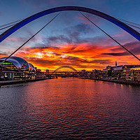 Buy canvas prints of Fiery sunset over Tyne Bridges, Newcastle  by Tom Hibberd