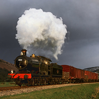 Buy canvas prints of  Goods train in the sun as a snowstorm approaches by Ian Duffield
