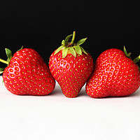 Buy canvas prints of Strawberries On Black Over White by Alan Harman