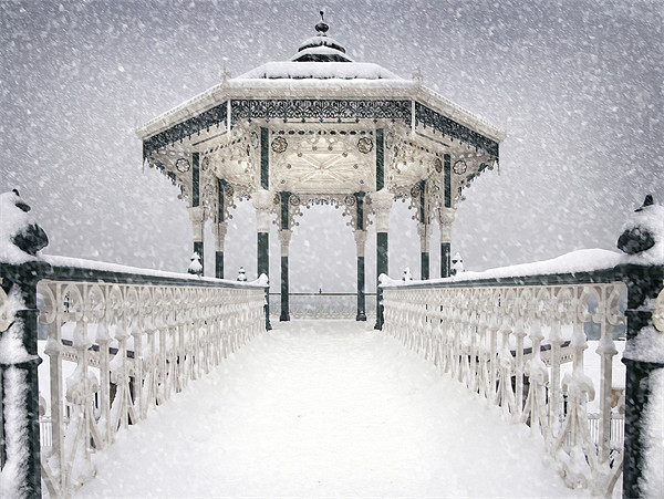 Bandstand in the snow Canvas print by Terry Busby