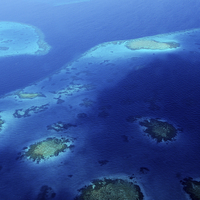 Buy canvas prints of  Maldivian Reefs. Aerial View  by Jenny Rainbow