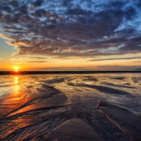 Buy canvas prints of Sunset on Cleveleys Beach by Gary Kenyon