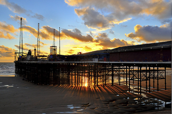 Suns Rays From Under South Pier - Blackpool Canvas print by Gary Kenyon