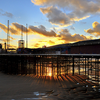 Buy canvas prints of Suns Rays From Under South Pier - Blackpool by Gary Kenyon