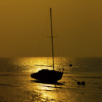 Buy canvas prints of Boat at sunset by Thanet Photos