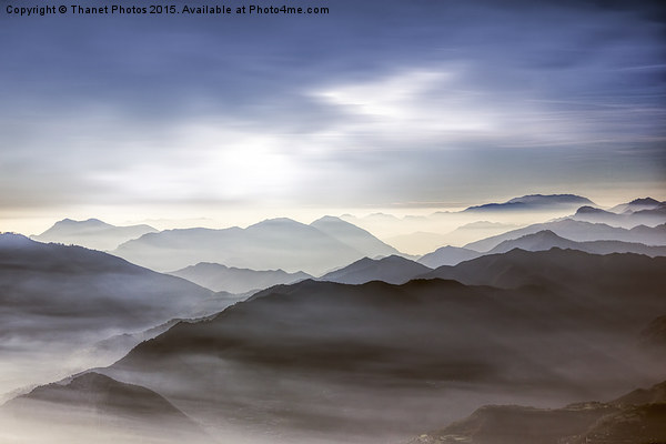 Misty mountains                         Canvas print by Thanet Photos