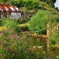 Buy canvas prints of  Sandsend Village Cottages and Stream by Martyn Arnold