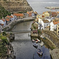 Buy canvas prints of Staithes fishing village, Yorkshire Coast by Martyn Arnold