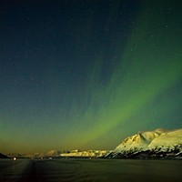 Buy canvas prints of Northern Lights Aurora near Tromso in Norway by Martyn Arnold