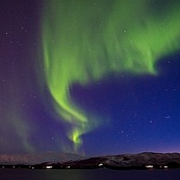 Buy canvas prints of Northern Lights over Tromso Norway by Martyn Arnold