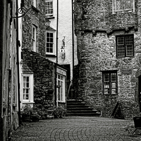 Buy canvas prints of Mono: Tudor Merchants House Tenby by Barrie Foster