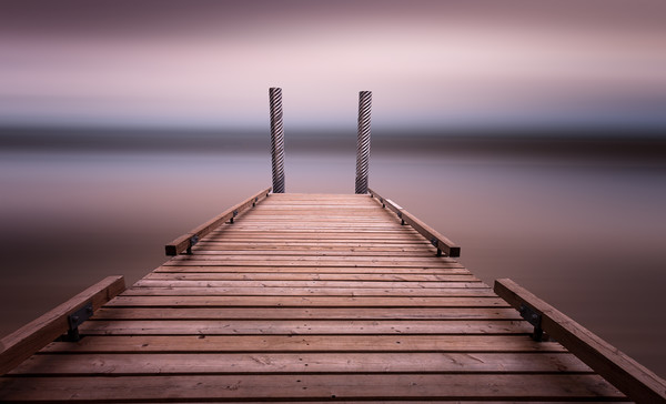 The jetty on Comox Lake Canvas Print by Leighton Collins
