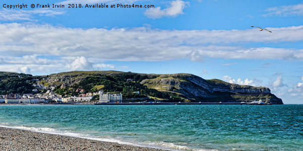 Dwarfing the pier, Llandudno's Great Orme Canvas print by Frank Irwin