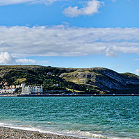 Buy canvas prints of Dwarfing the pier, Llandudno's Great Orme by Frank Irwin