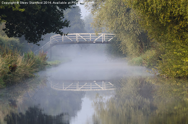 Canal bridge in the mist  Canvas print by Steev Stamford