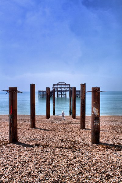 Man looking out to The West Pier Canvas Print by Paul Austen
