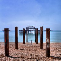 Buy canvas prints of Man looking out to The West Pier by Paul Austen