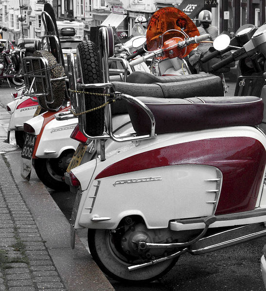 A row of Scooters Canvas Print by Paul Austen