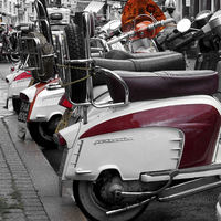 Buy canvas prints of A row of Scooters by Paul Austen