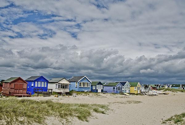 Mudeford spit beach huts Canvas print by dan ward