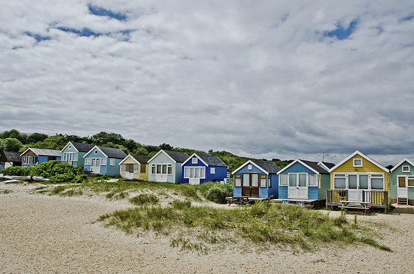 Beach huts on Mudeford Spit Canvas print by dan ward