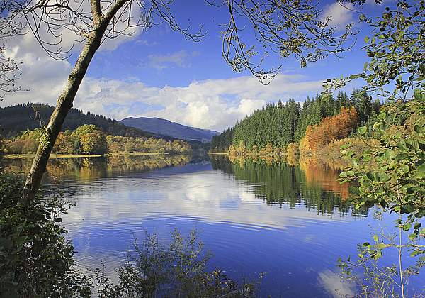 Reflections on a scottish loch Canvas print by Peter Mclardy