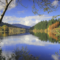 Buy canvas prints of Reflections on a scottish loch by Peter Mclardy