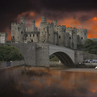Buy canvas prints of Dramatic Sky Over Castell Conwy by rawshutterbug
