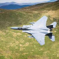 Buy canvas prints of Low Flying F-15E Strike Eagle by rawshutterbug