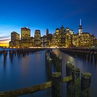 Buy canvas prints of Manhattan Sunset by Kevin Ainslie