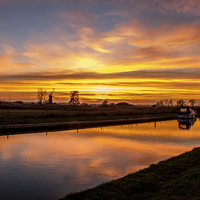 Buy canvas prints of Sunset Thurne Dyke Norfolk Broads by James Taylor