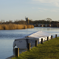 Buy canvas prints of Little boat alone on the River Thurne, Martham, No by James Taylor
