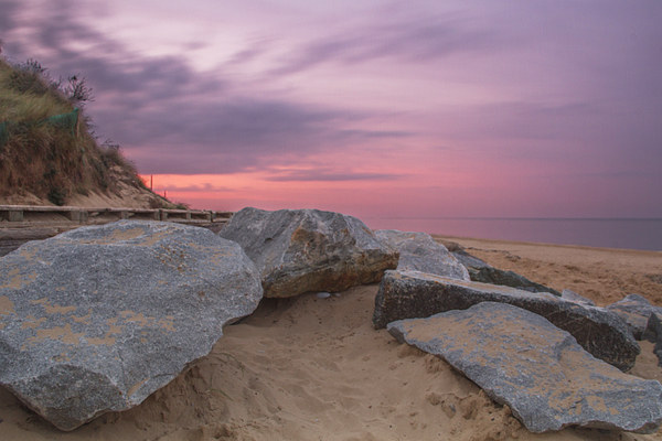 Sunset by the Rocks at Hemsby Beach Canvas Print by James Taylor