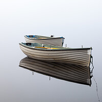 Buy canvas prints of Boats reflected on a perfectly still loch. by Tommy Dickson