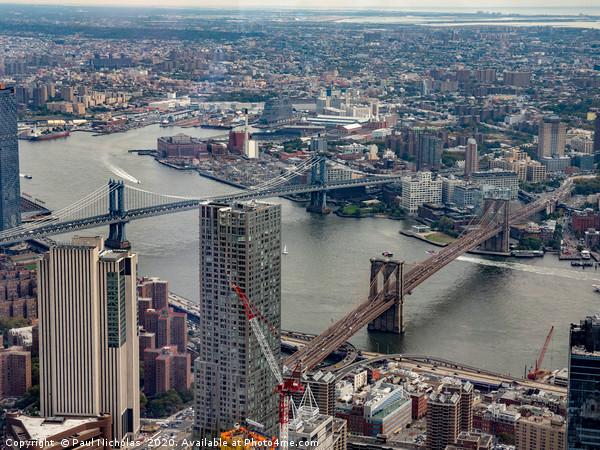 Two bridges in New York Canvas print by Paul Nicholas