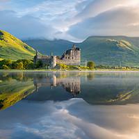Buy canvas prints of Dawn at Kilchurn castle, Loch Awe, Scotland, UK by Daugirdas Racys