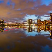 Buy canvas prints of London Royal Victoria docks reflections at dusk by Daugirdas Racys